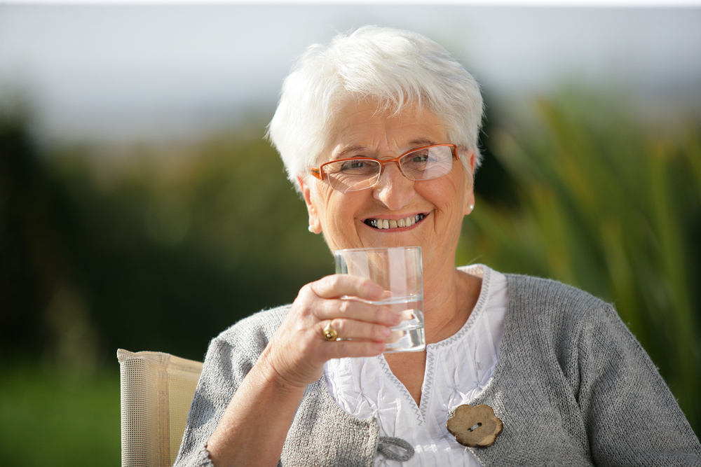 Senior happy about her home water filtration system.